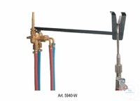 Gas economiser with adjustable pilot flame and safety support Gas economiser...
